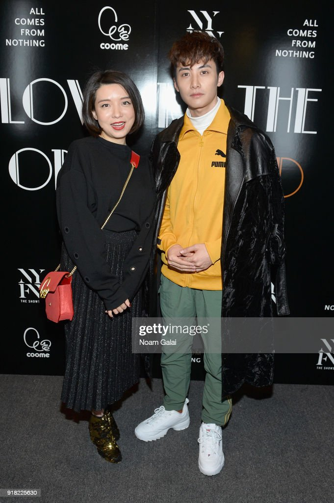 Designer Eva Yiwei Xu (L) poses with a guest backstage for the All Comes From Nothing x COOME FW18 show at Gallery II at Spring Studios on February 14, 2018 in New York City.