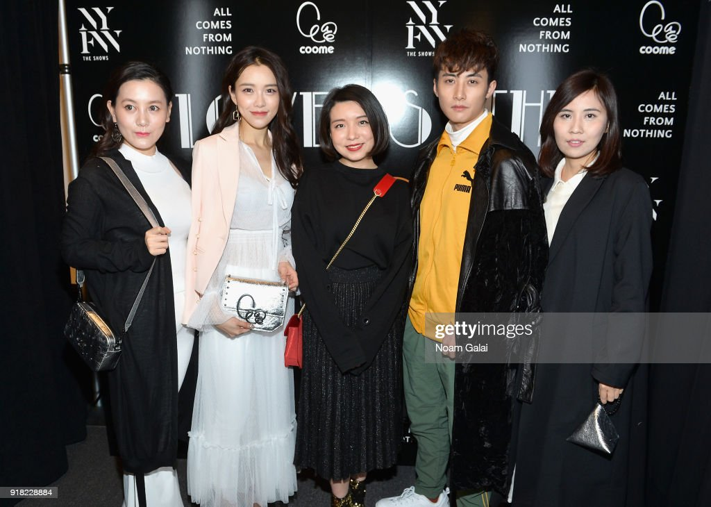 Designer Eva Yiwei Xu (center) poses with guests backstage for the All Comes From Nothing x COOME FW18 show at Gallery II at Spring Studios on February 14, 2018 in New York City.