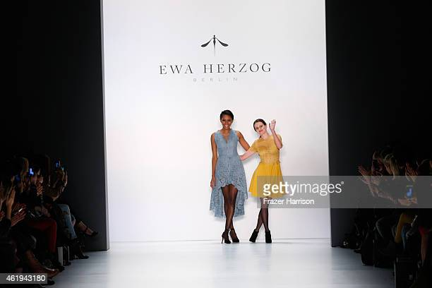 Designer Ewa Herzog and a model walk the runway at the Ewa Herzog show during the MercedesBenz Fashion Week Berlin Autumn/Winter 2015/16 at...