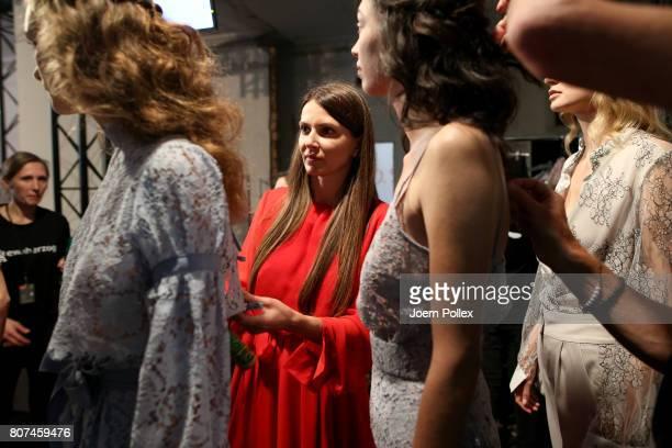 Designer Ewa Herzog talks to models backstage ahead of the Ewa Herzog show during the MercedesBenz Fashion Week Berlin Spring/Summer 2018 at Kaufhaus...