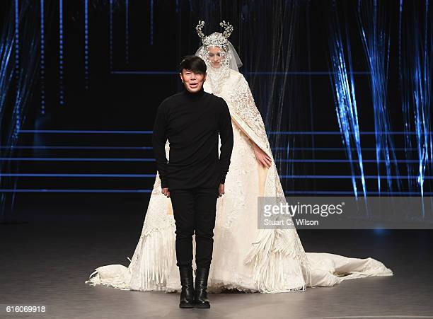 Designer Ezra poses at the runway after the Ezra show during Fashion Forward Spring/Summer 2017 at the Dubai Design District on October 21 2016 in...