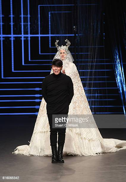 Designer Ezra poses at the runway at the Ezra show during Fashion Forward Spring/Summer 2017 at the Dubai Design District on October 21 2016 in Dubai...