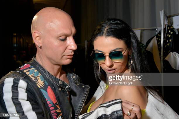 Designer Ezra Tuba and a model are seen backstage at the Ezra Tuba show during MercedesBenz Istanbul Fashion Week on March 21 2019 in Istanbul Turkey