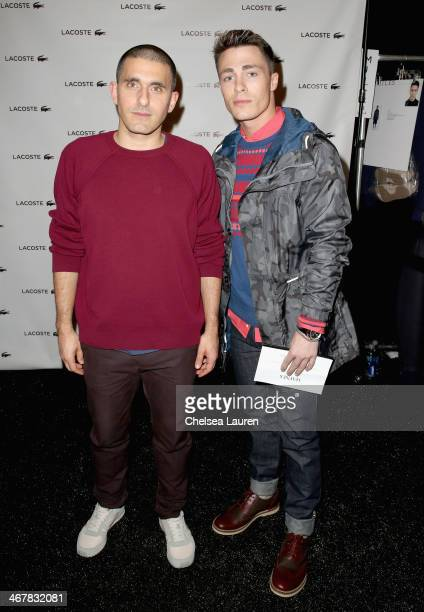 Designer Felipe Oliveira Baptista and Colton Haynes pose backstage at the Lacoste fashion show during MercedesBenz Fashion Week Fall 2014 at The...