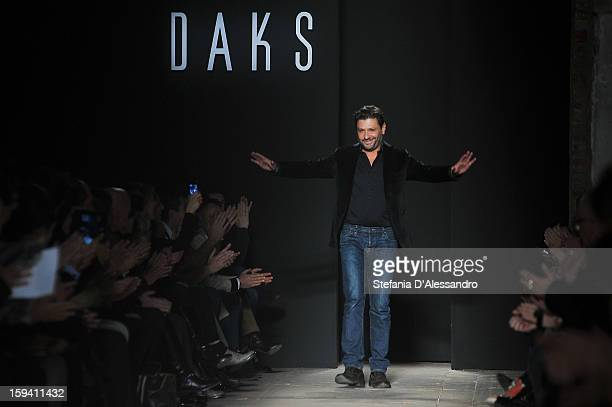Designer Filippo Scuffi acknowledge the audience at the end of the Daks show as part of Milan Fashion Week Menswear Autumn/Winter 2013 on January 13...