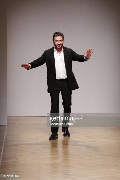 Designer Filippo Scuffi acknowledges the applause of the audience after the Daks show during Milan Men's Fashion Week Spring/Summer 2018 on June 18...
