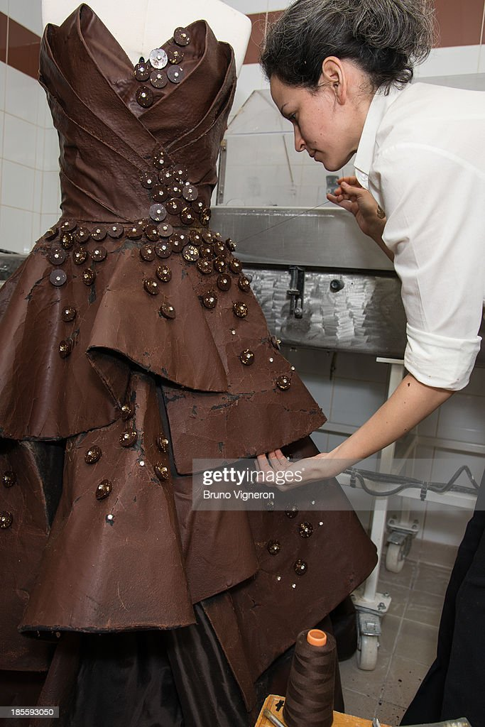 Designer Florencia Soerensen creates a chocolate dress on October 22, 2013 in Lyon, France. The six kilogram chocolate dress is made from golden leafs and savage silk and is to be worn by former professional tennis player Marion Bartoli at the Paris chocolate trade show 'Salon du Chocolat' on October 29, 2013 at Porte de Versailles.