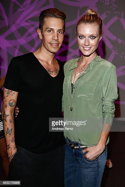 Designer Florian Wess and Anastassija Makarenko attend the GarconF fashion show at BalloniHallen on August 5 2014 in Cologne Germany