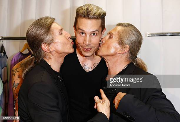 Designer Florian Wess with Arnold and Oskar Wess attend GarconF fashion show at BalloniHallen on August 5 2014 in Cologne Germany