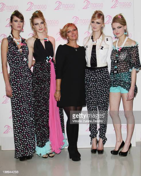Designer Francesca Severi poses with models during the 22 Maggio By Maria Grazia Severi collection are displayed on February 14, 2012 in Milan, Italy.