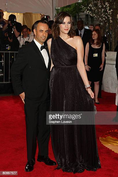 Designer Francisco Costa and sctress Liv Tyler arrive at the Metropolitan Museum of Art Costume Institute Gala Superheroes Fashion and Fantasy held...