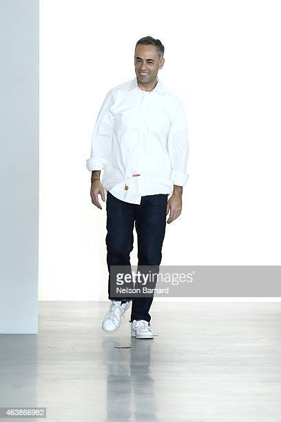 Designer Francisco Costa walks the runway at the Calvin Klein Collection fashion show during MercedesBenz Fashion Week Fall 2015 at Spring Studios on...