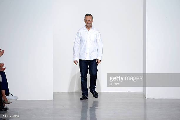 Designer Francisco Costa walks the runway wearing Calvin Klein Collection Fall 2016 during New York Fashion Week at Spring Studios on February 18...
