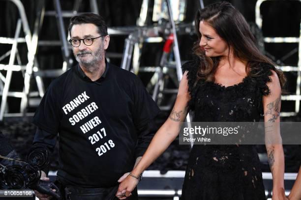 Designer Franck Sorbier and the Godmother of the Collection daughter of Lio singer Nubia Esteban acknowledge the audience after the Franck Sorbier...