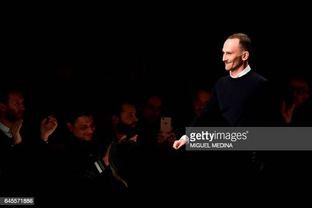 Designer Fulvio Rigoni greets the audience at the end of the show for fashion house Salvatore Ferragamo during the Women's Fall/Winter 2017/2018...