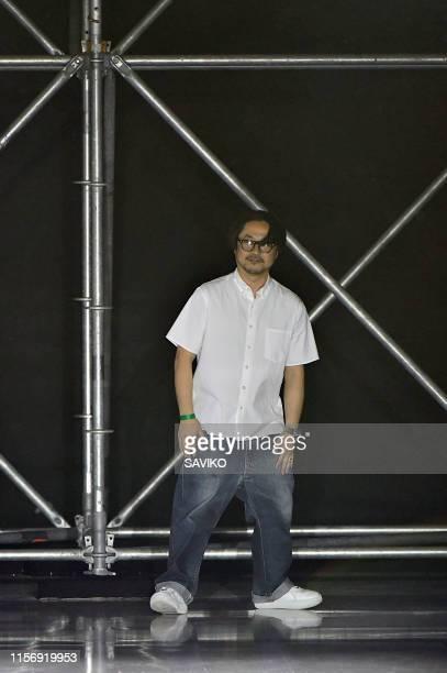 Designer Fumito Ganryu walks the runway at the Fumito Ganryu fashion show during Paris Men's Fashion Week Spring/Summer 2020 on June 18, 2019 in...