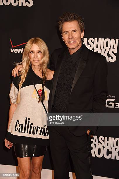 Designer Gela Nash and John Taylor of Duran Duran attend Fashion Rocks 2014 at the Barclays Center on September 9 2014 in New York City