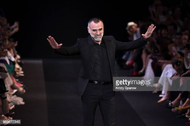 Designer George Hobeika acknowledges the audience during the George Hobeika Haute Couture Fall Winter 2018/2019 show as part of Paris Fashion Week on...