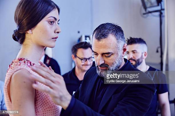 Designer George Hobeika is seen backstage with a model prior the George Hobeika show as part of Paris Fashion Week Haute Couture Fall/Winter...