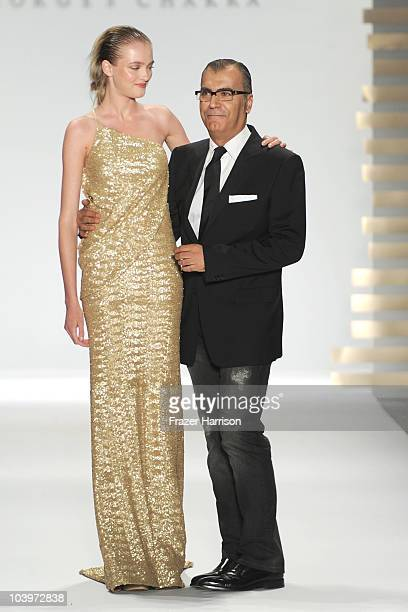 Designer Georges Chakra and a model walk the runway at the Edition by Georges Chakra Spring 2011 fashion show during MercedesBenz Fashion Week at The...