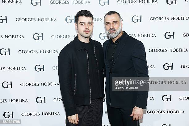 Designer Georges Hobeika is pictured with his son Jad Hobeika at the end of his Haute Couture Spring Summer 2017 show as part of Paris Fashion Week...