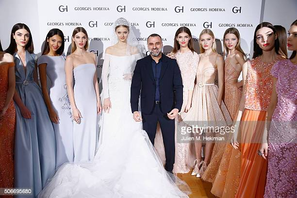 Designer Georges Hobeika is pictured with models after his Haute Couture show Spring/Summer 2016 Fashion Show as part of Paris Fashion Week at...