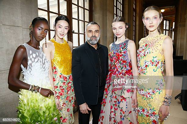 Designer Georges Hobeika is pictured with models at the end of his Haute Couture Spring Summer 2017 show as part of Paris Fashion Week on January 23...