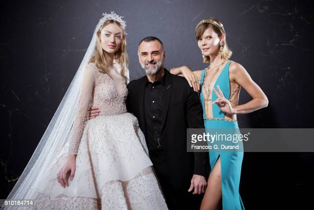 Designer Georges Hobeika is seen with model Irina Kravchenko backstage prior the Georges Hobeika Spring Summer 2018 show as part of Paris Fashion...