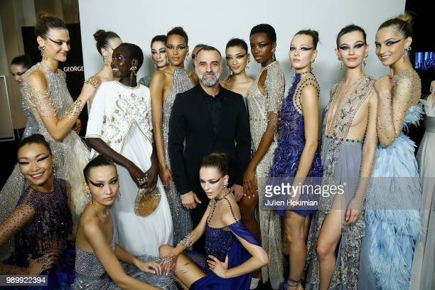 Designer Georges Hobeika poses with models after the final of the Georges Hobeika Haute Couture Fall Winter 2018/2019 show as part of Paris Fashion...