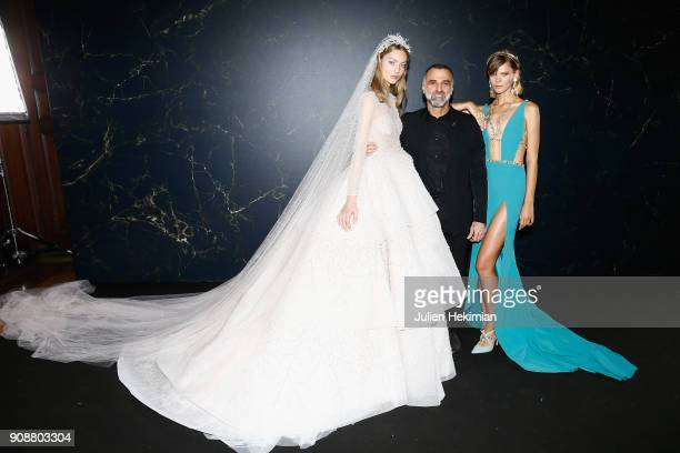 Designer Georges Hobeika poses with models backstage after the Georges Hobeika Spring Summer 2018 show as part of Paris Fashion Week on January 22...