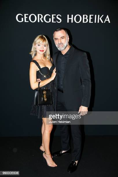 Designer Georges Hobeika poses with Pauline Baly after the final of the George Hobeika Haute Couture Fall Winter 2018/2019 show as part of Paris...