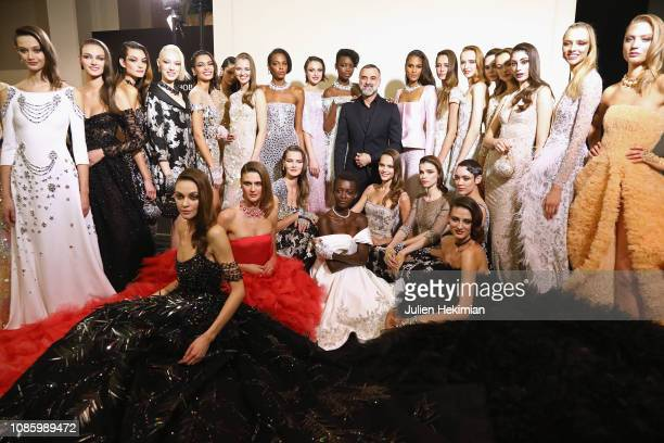 Designer Georges Hobeika poses with the models after the Georges Hobeika Haute Couture Spring Summer 2019 show as part of Paris Fashion Week on...