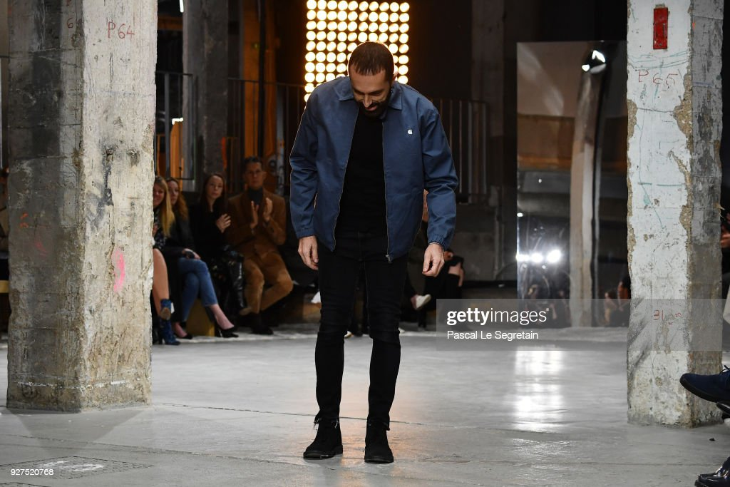 Designer Giambattista Valli acknowledges the applause of the audience after the Giambattista Valli show as part of the Paris Fashion Week Womenswear Fall/Winter 2018/2019 on March 5, 2018 in Paris, France.