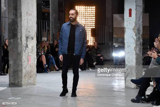Designer Giambattista Valli acknowledges the applause of the audience after the Giambattista Valli show as part of the Paris Fashion Week Womenswear...