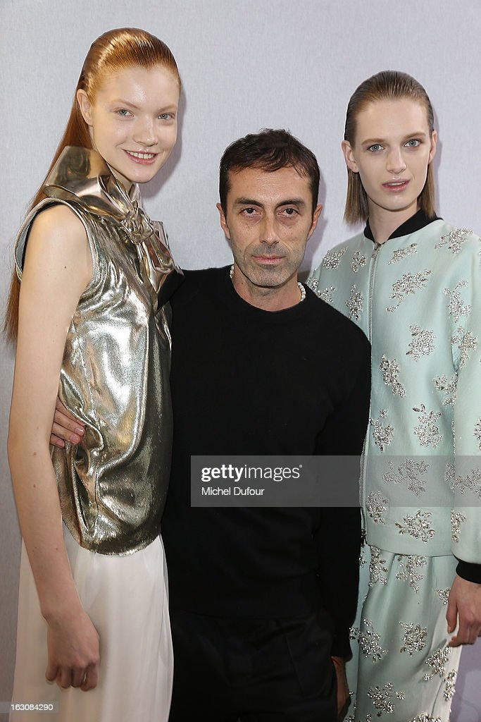 Designer Giambattista Valli (C) poses with models backstage at the Giambattista Valli Fall/Winter 2013 Ready-to-Wear show as part of Paris Fashion Week on March 4, 2013 in Paris, France.
