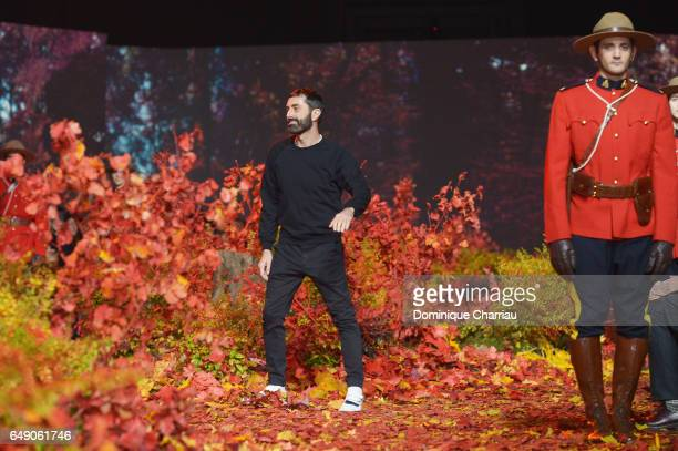 Designer Giambattista Valli walks the runway during the Moncler Gamme Rouge Paris show as part of the Paris Fashion Week Womenswear Fall/Winter...