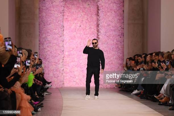 Designer Giambattista Valli waves to the audience during the Giambattista Valli show as part of the Paris Fashion Week Womenswear Fall/Winter...