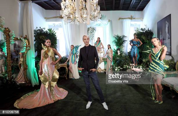 Designer Gianni Molaro poses with models at his Performance Il Giardino incantato Fall/Winter 2017/18 during AltaRoma on July 7 2017 in Rome Italy