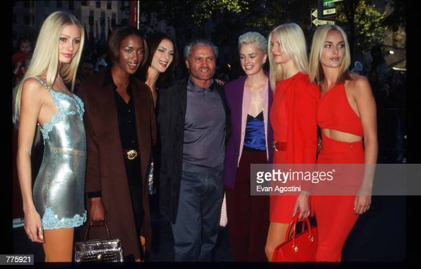 Designer Gianni Versace stands with models October 25, 1996 in New York City. Versace made a guest appearance on the Today Show and staged a runway...