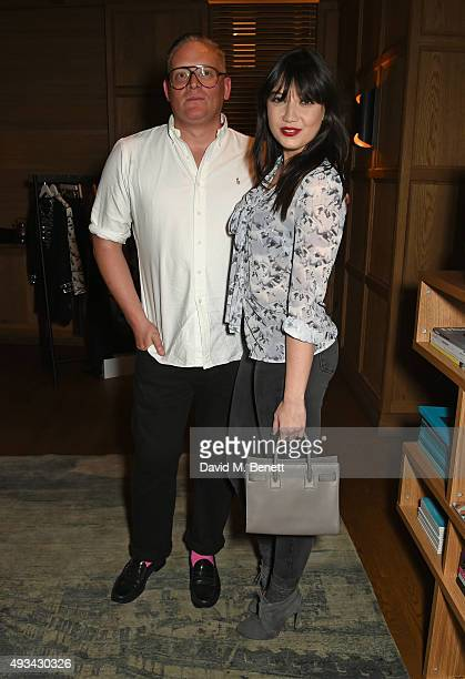 Designer Giles Deacon and Daisy Lowe attend a cocktail reception hosted by Giles Deacon to celebrate the launch of the Giles/EDITION collection for...