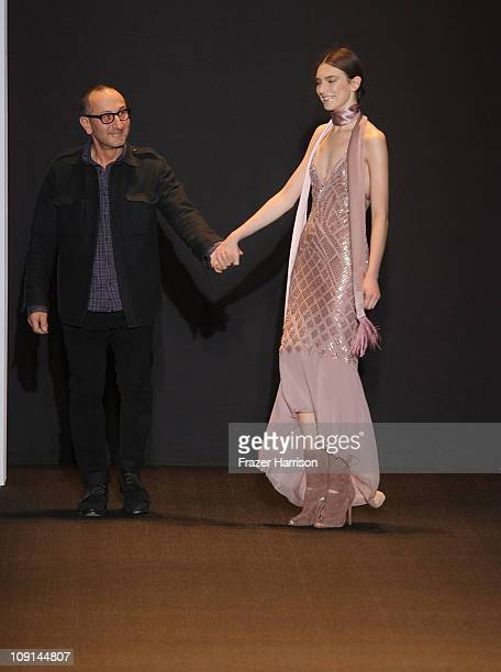 Designer Gilles Mendel walks with a model on the runway at the J Mendel Fall 2011 fashion show during MercedesBenz Fashion Week at the NY State...