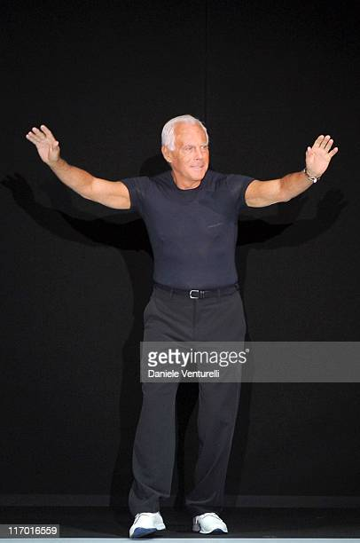 Designer Giorgio Armani acknowledge the applause of the audience after the Emporio Armani fashion show as part of Milan Fashion Week Menswear...