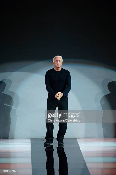 Designer Giorgio Armani acknowledges the appaluse of the pubblic after the Emporio Armani fashion show as part of Milan Fashion Week Autumn/Winter...