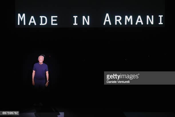 Designer Giorgio Armani acknowledges the applause of the audience at the Giorgio Armani show during Milan Men's Fashion Week Spring/Summer 2018 on...
