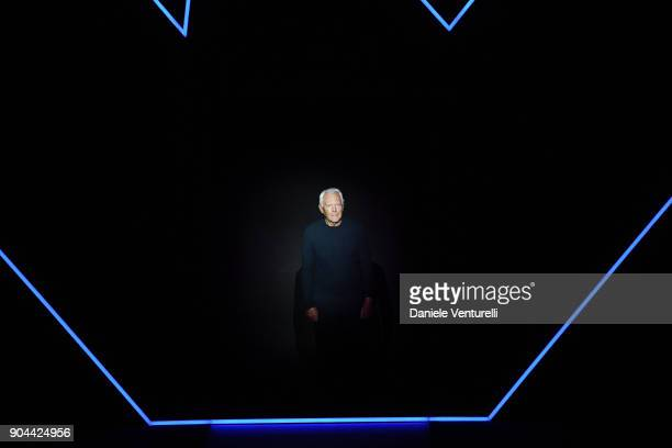 Designer Giorgio Armani acknowledges the applause of the audience at the at the Emporio Armani show during Milan Men's Fashion Week Fall/Winter...