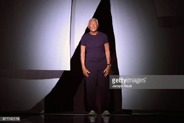 Designer Giorgio Armani acknowledges the applause of the audience at the Giorgio Armani show during Milan Men's Fashion Week Spring/Summer 2019 on...
