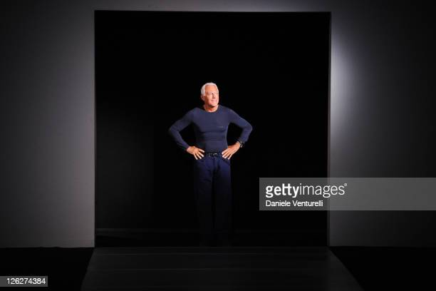 Designer Giorgio Armani acknowledges the applause of the audience after the Emporio Armani fashion show as part of Milan Fashion Week Womenswear...