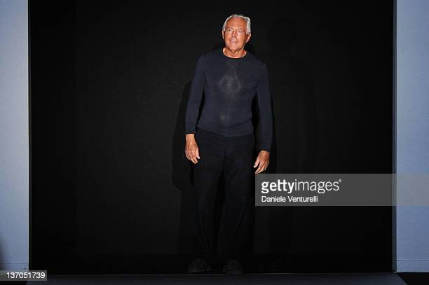 Designer Giorgio Armani acknowledges the applause of the audience after the Emporio Armani fashion show as part of Milan Fashion Week Menswear...