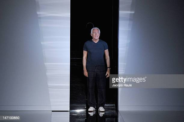 Designer Giorgio Armani acknowledges the applause of the audience after the Emporio Armani show as part of Milan Fashion Week Menswear Spring/Summer...