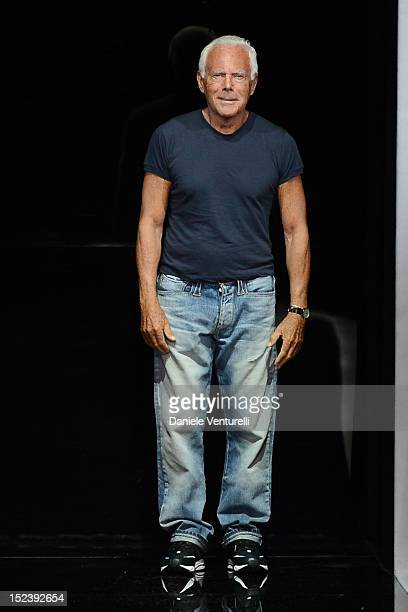 Designer Giorgio Armani acknowledges the applause of the audience after the Emporio Armani Fashion Show as part of Milan Fashion Week Womenswear S/S...